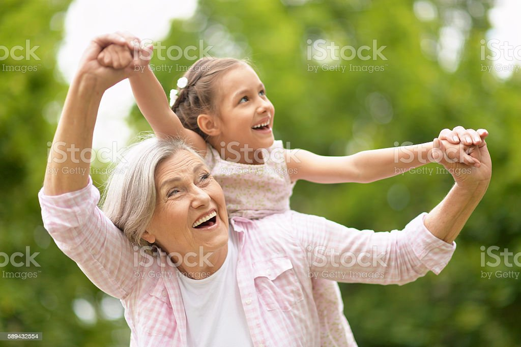 Grandmother with granddaughter  in park stock photo