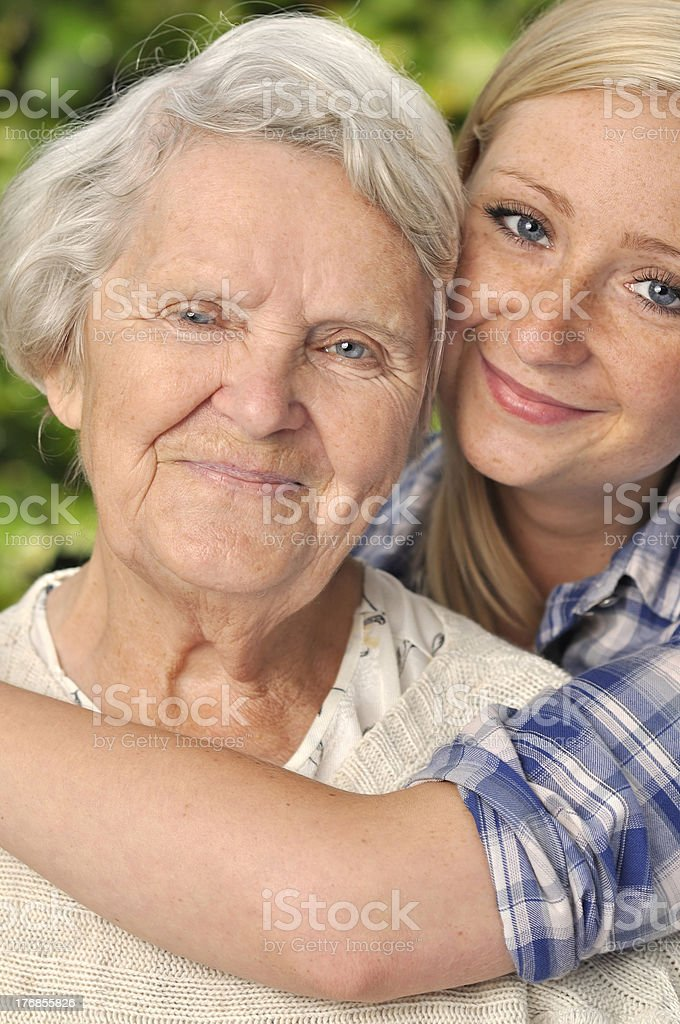 Grandmother with granddaughter. Smiling and happy royalty-free stock photo