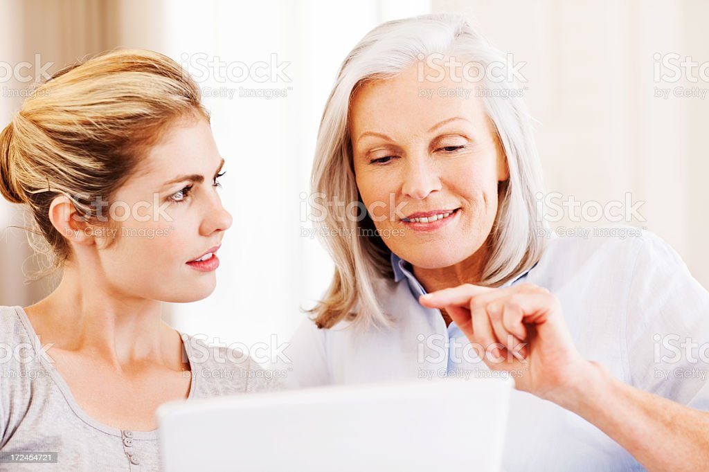 Grandmother With Granddaughter Using Digital Tablet royalty-free stock photo