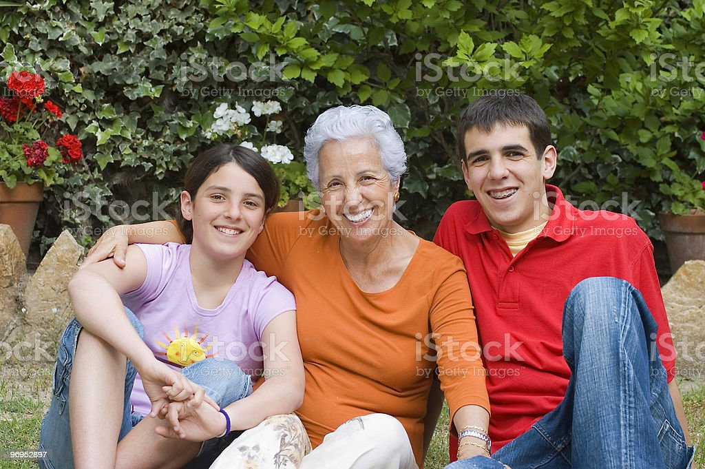 Grandmother with grandson and granddaughter stock photo