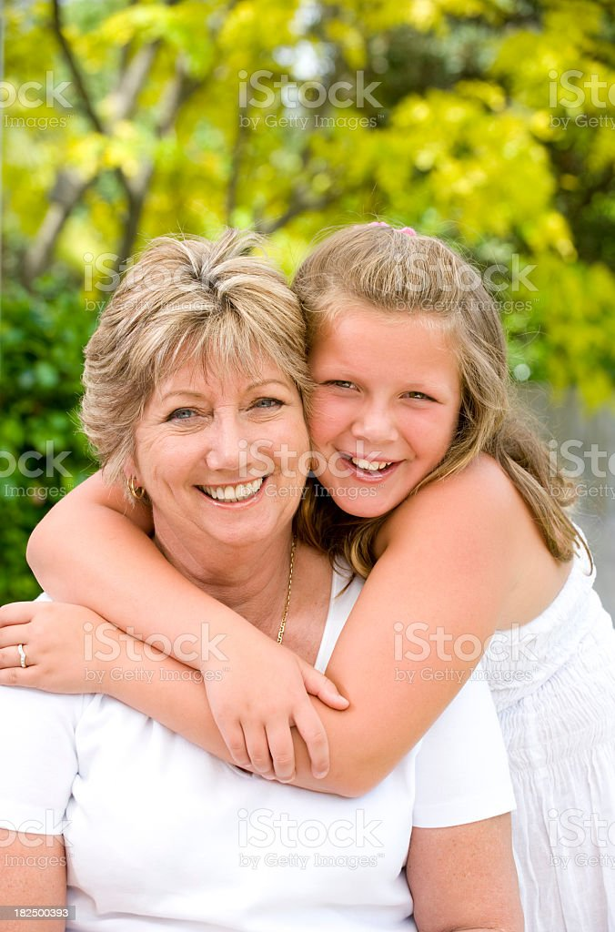 Grandmother with her grandaughter smiling royalty-free stock photo
