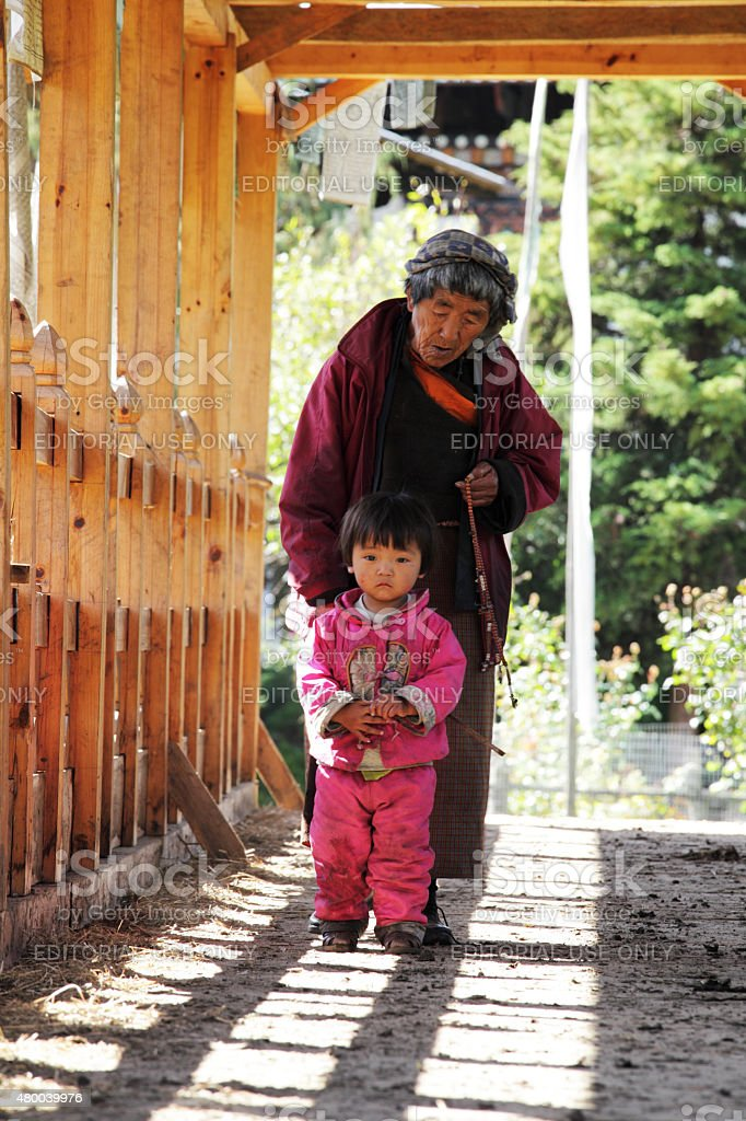 Grandmother with her grandchild in Bhutan. stock photo