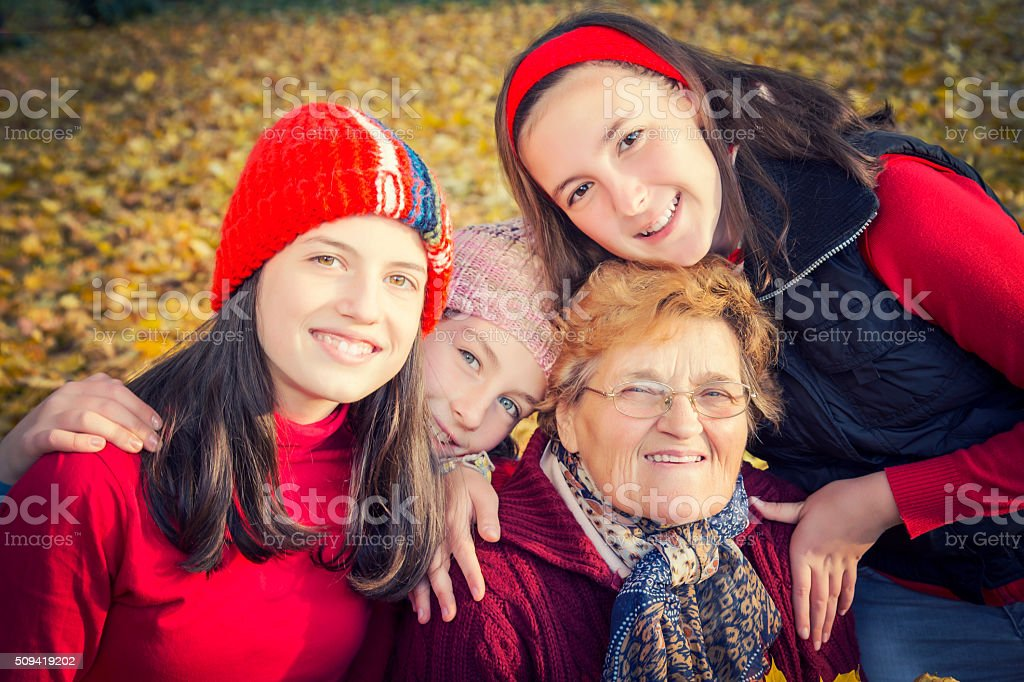 Grandmother with her granddoughters in a park royalty-free stock photo