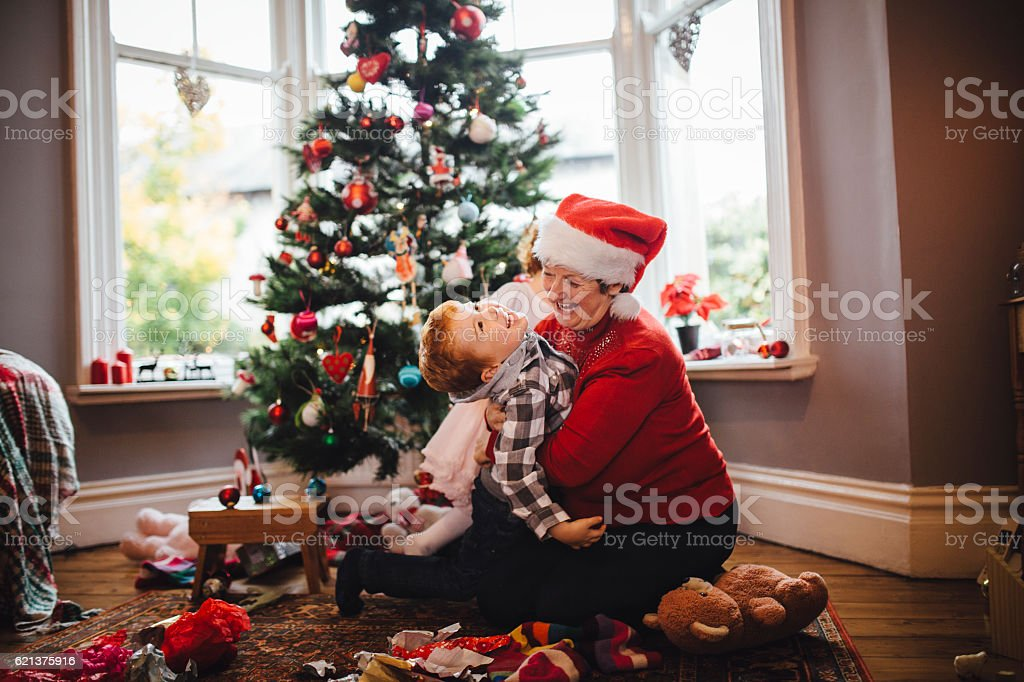 Grandmother with her Grandson on Christmas Day stock photo