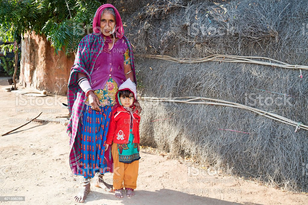 Grandmother with her small grandson, Bishnoi village, Rajasthan, India stock photo