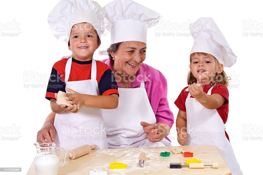 Grandmother with kids making cookies royalty-free stock photo