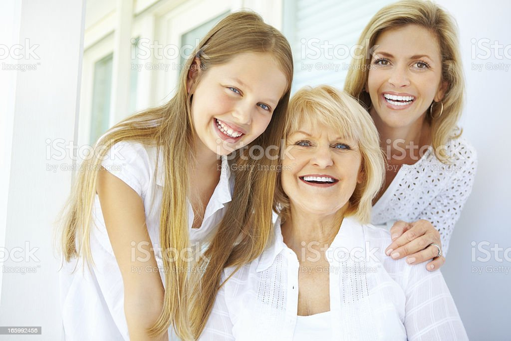 Grandmother with mature daughter and granddaughter smiling royalty-free stock photo
