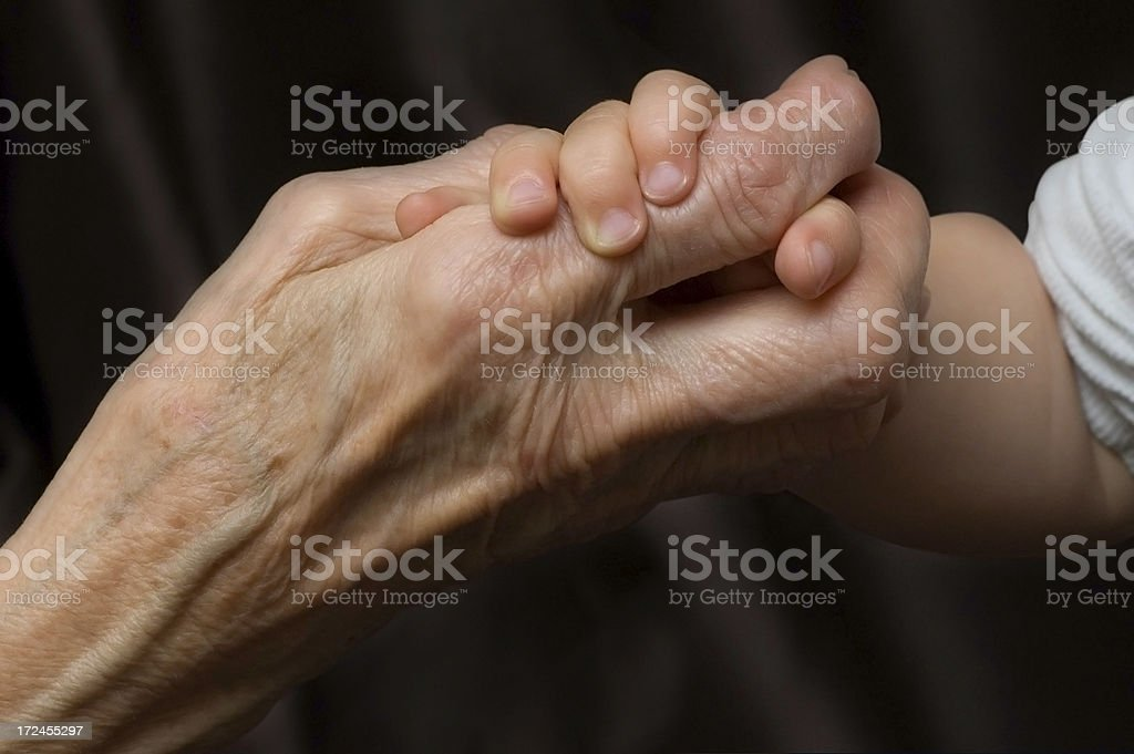 Grandmother's and child's hands royalty-free stock photo
