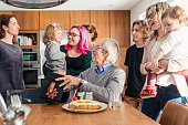 Grandpa 75th birthday celebration with three generation family at home.