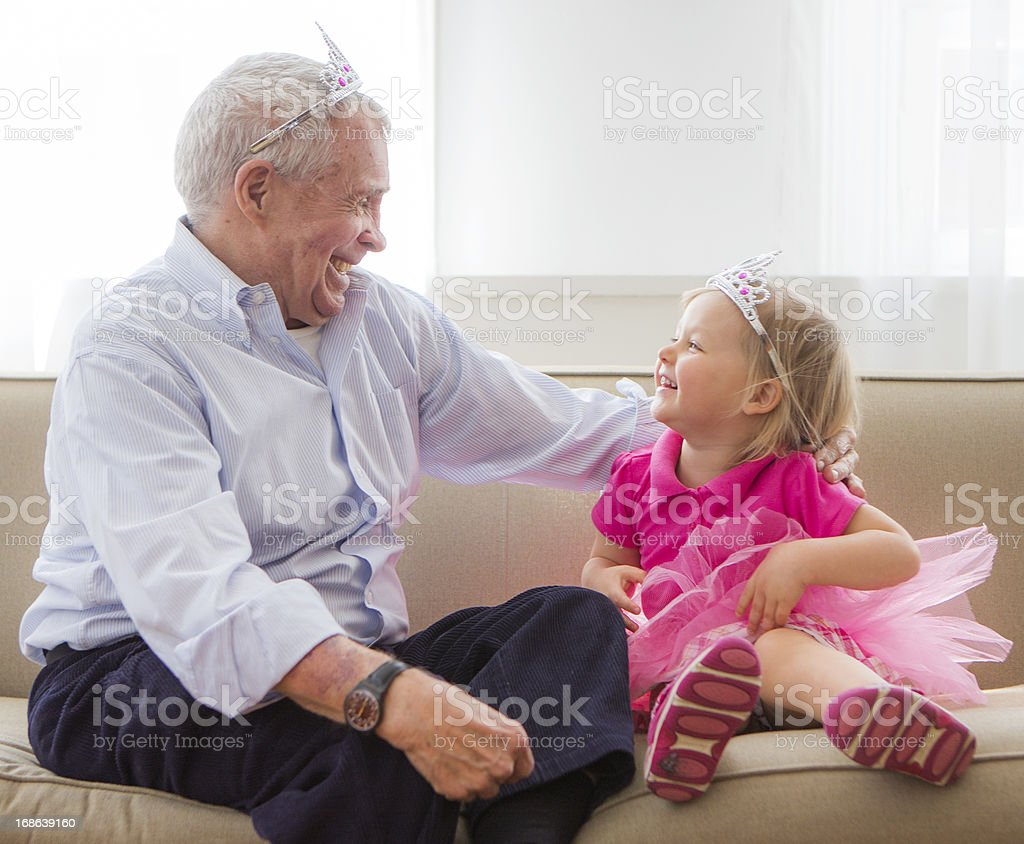 Grandpa and grandaughter playing princess stock photo