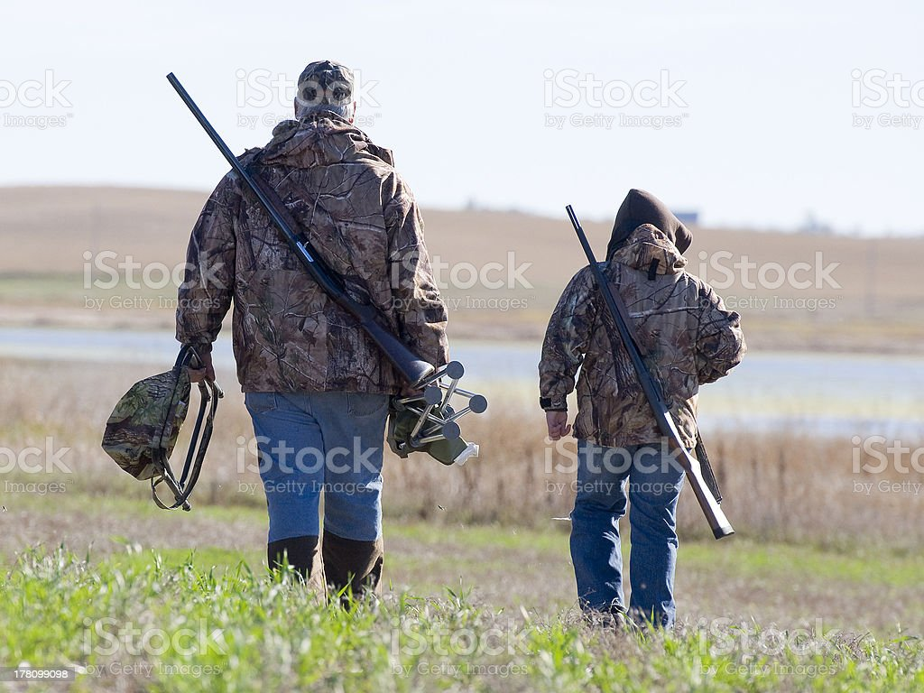 Grandpa and Grandson going Duck Hunting stock photo