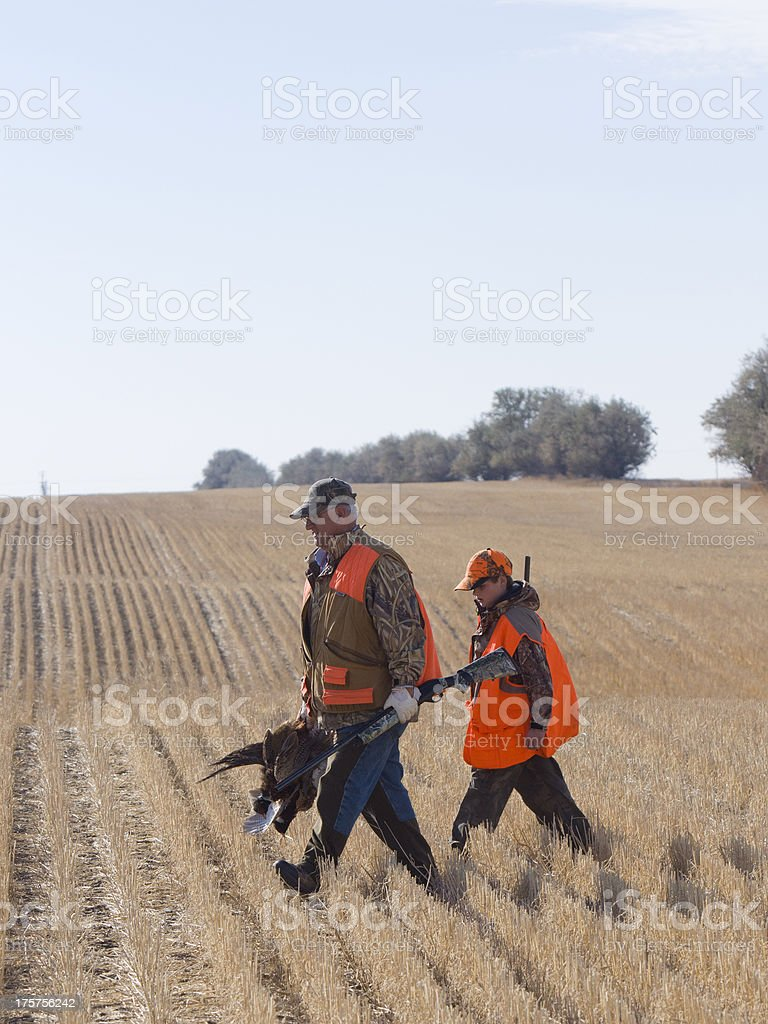 Grandpa and Grandson Hunting stock photo