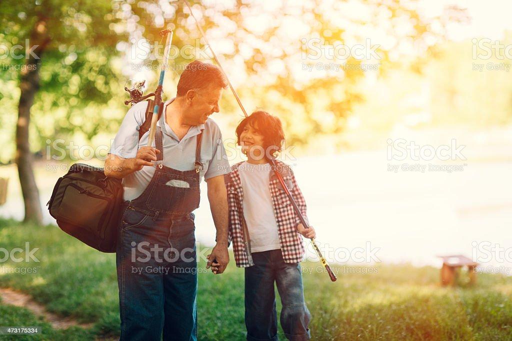 Grandpa and grandson on fishing. stock photo