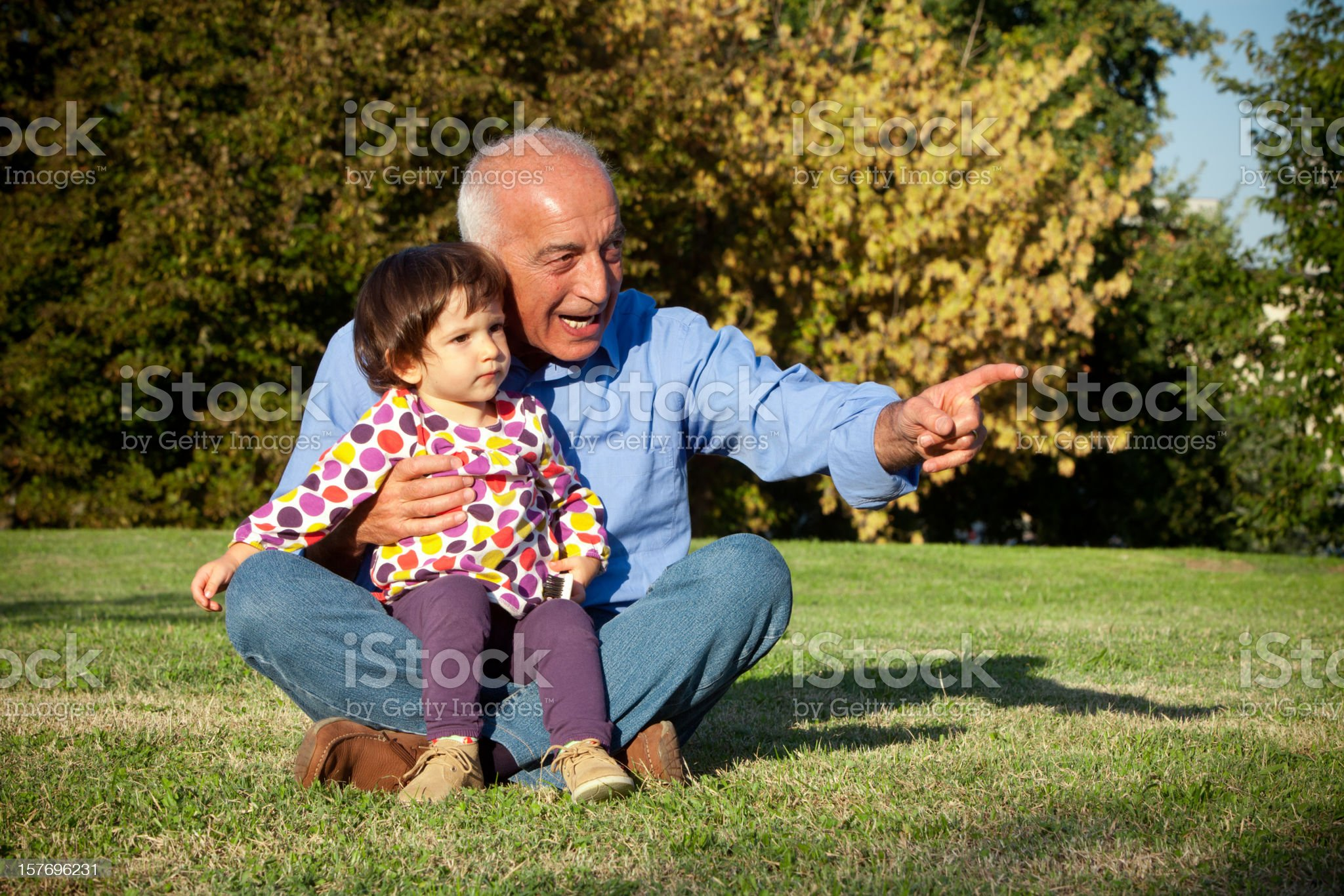 Grandpa and niece looking far royalty-free stock photo