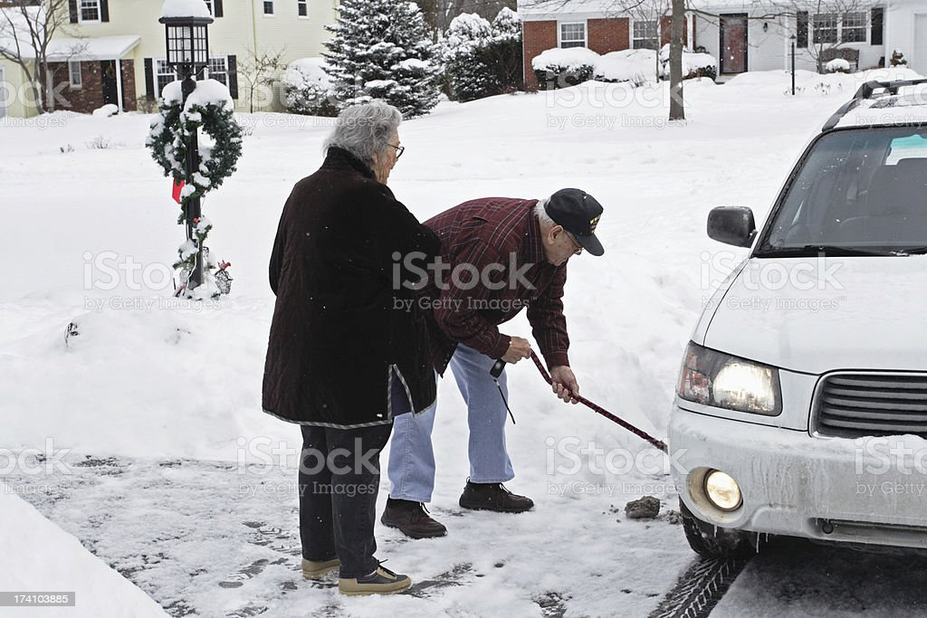 Grandpa Cleaning Tire Slush stock photo