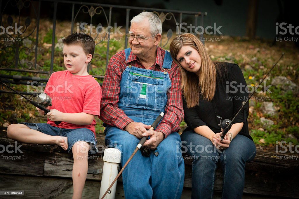 Grandpa Fishing With His Granddaughter and Great Grandson stock photo
