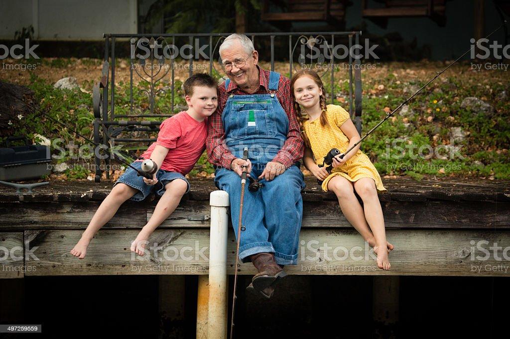 Grandpa Fishing With His Great Grandchildren stock photo
