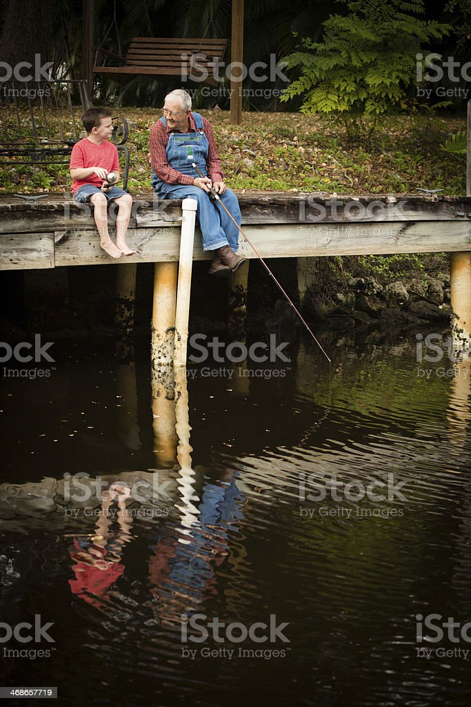 Grandpa Fishing With His Great Grandson stock photo