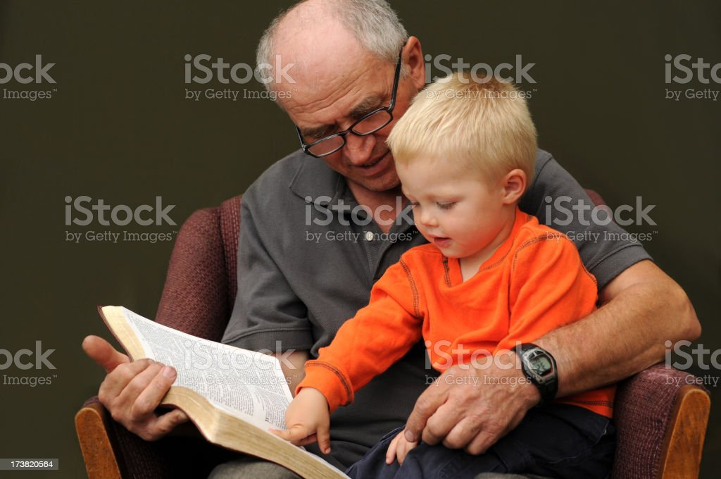 grandpa reading royalty-free stock photo