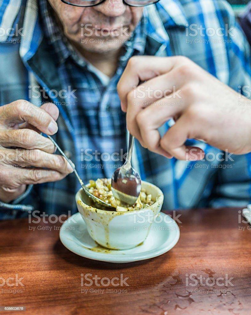 Grandpa Sharing Cup of Vegetable Soup Lunch With Grandson stock photo