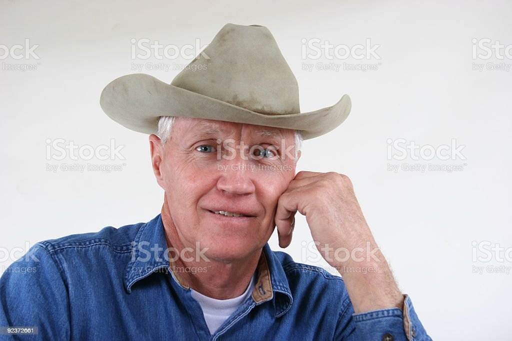Grandpa wearing his favorite old felt hat, soiled and dirty. royalty-free stock photo