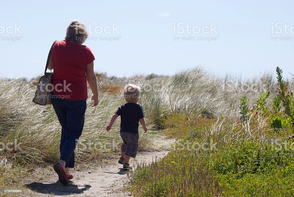 Grandparent and Grandchild on walk stock photo