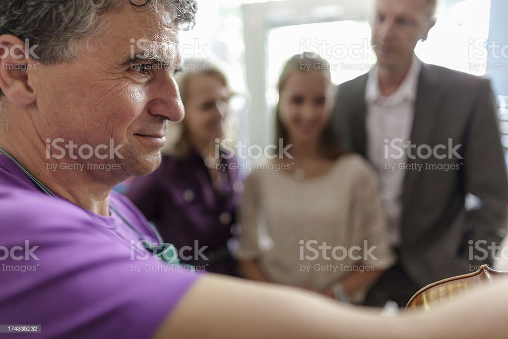Grandparent buying Granddaughter First Violin stock photo