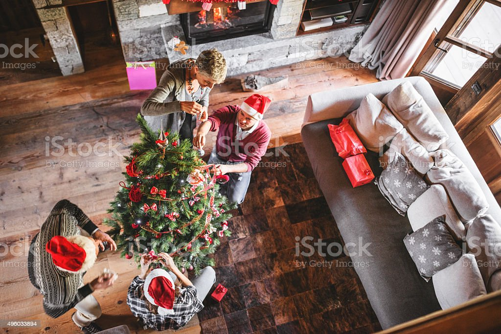 grandparent making the christmas tree stock photo