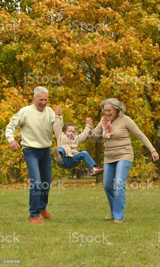 Grandparents and grandchild stock photo