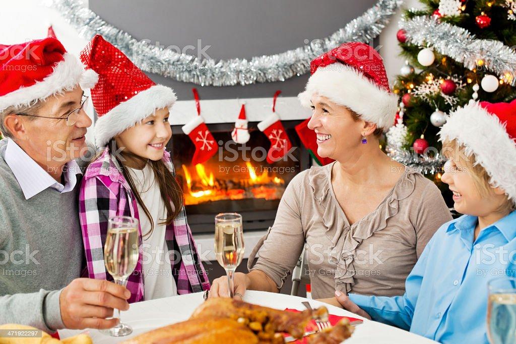 Grandparents and grandchildren celebrating Christmas. royalty-free stock photo