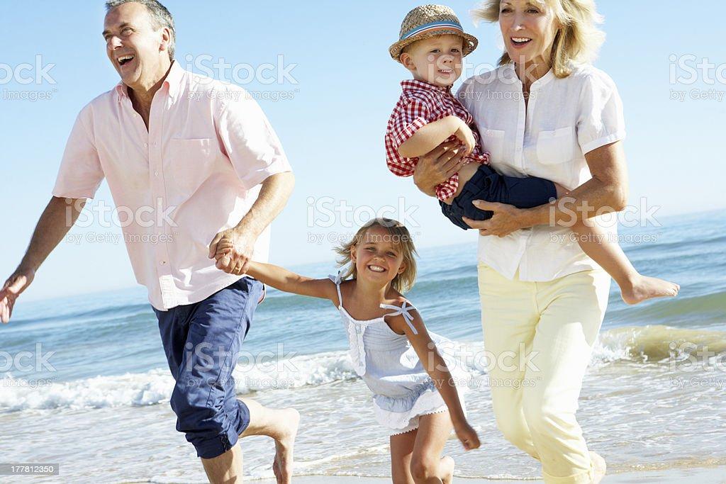 Grandparents And Grandchildren Enjoying Beach Holiday royalty-free stock photo