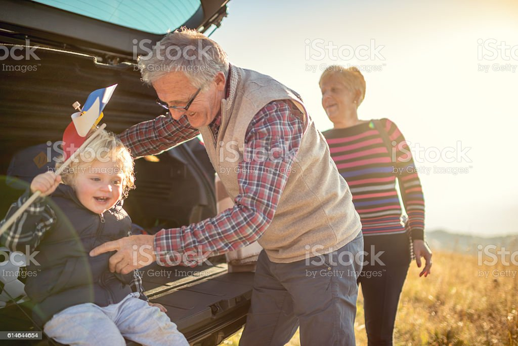 Grandparents and grandson outdoors stock photo