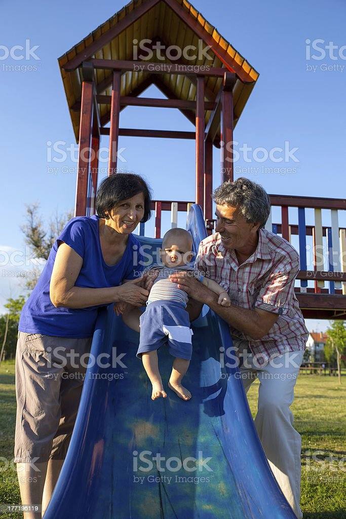 grandparents and her grandson playing royalty-free stock photo