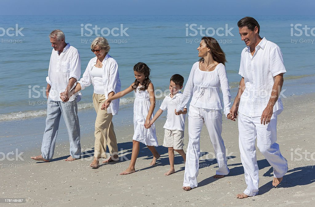 Grandparents, Mother, Father Children Family Walking Beach royalty-free stock photo