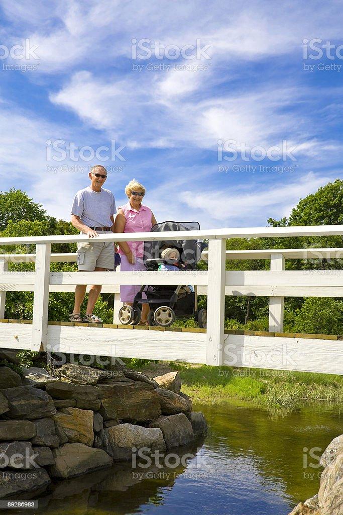 Grandparents on a bridge royalty-free stock photo