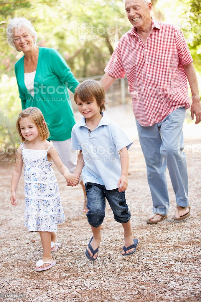 Grandparents On Country Walk With Grandchildren royalty-free stock photo