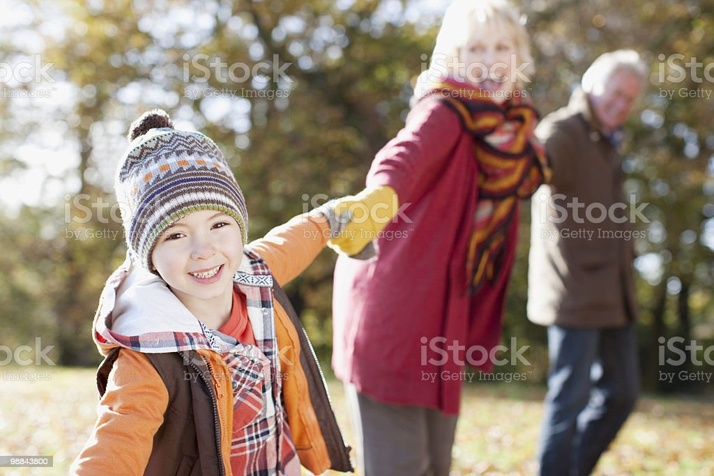 Grandparents playing in park with grandson royalty-free stock photo