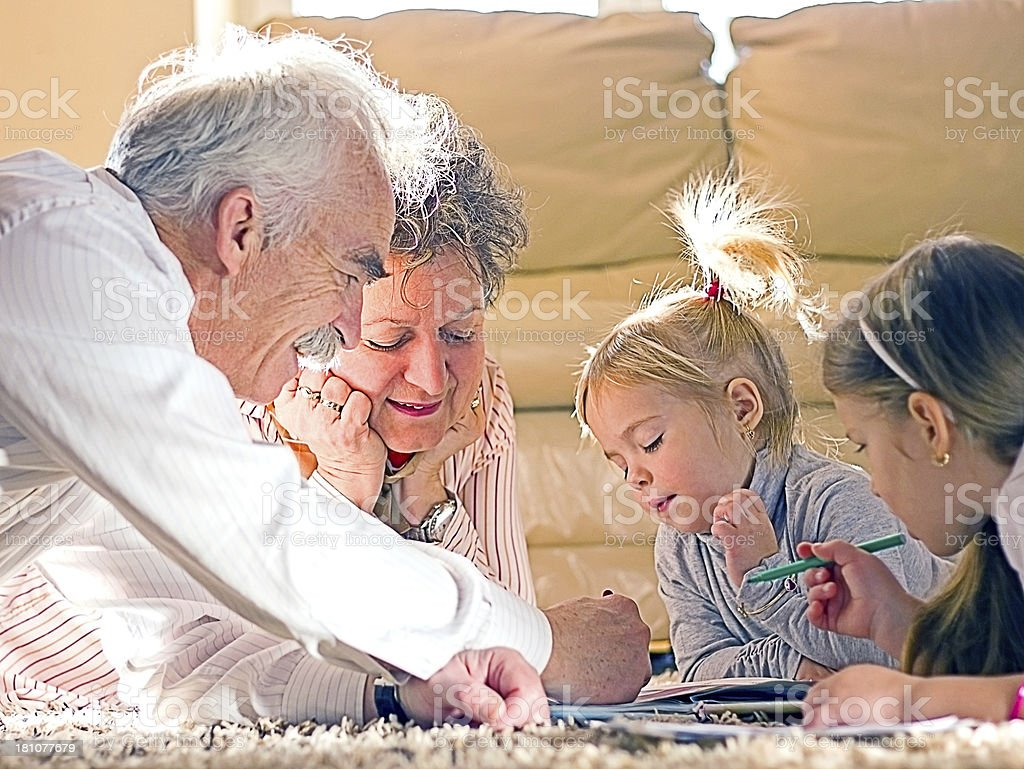 Grandparents playing with their granddauthers. royalty-free stock photo