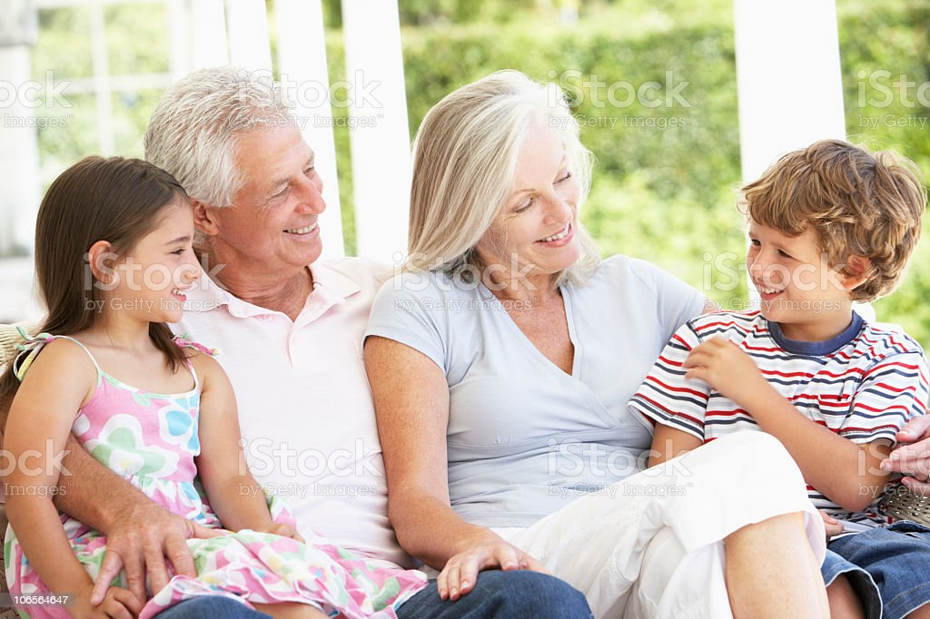 Grandparents Sitting Outisde with Grandchildren royalty-free stock photo