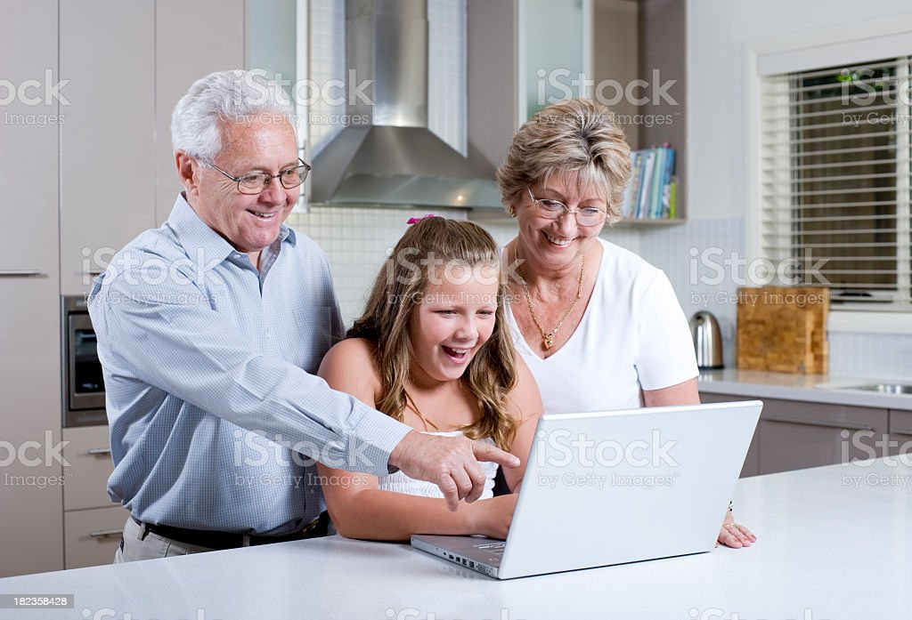 Grandparents using a laptop royalty-free stock photo