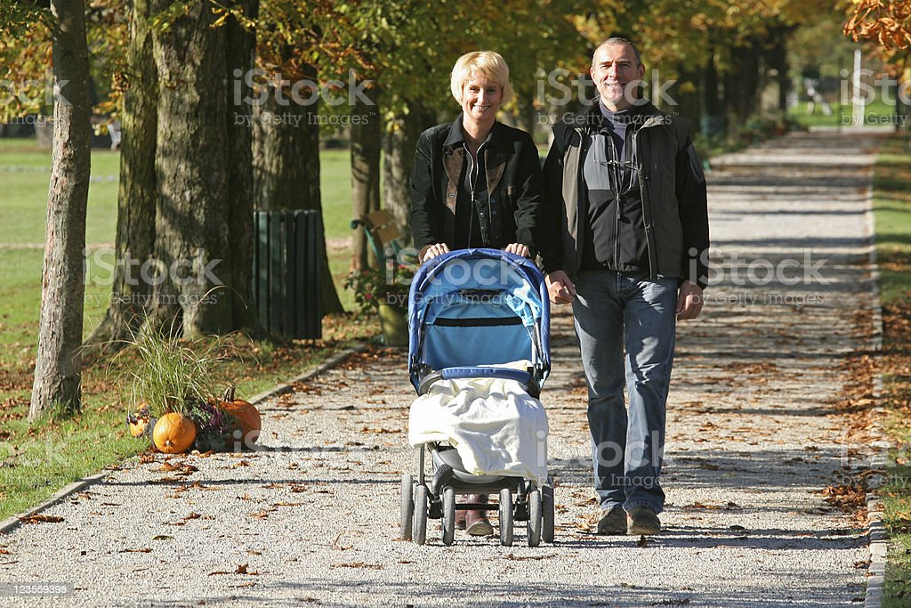 Grandparents walking the baby royalty-free stock photo