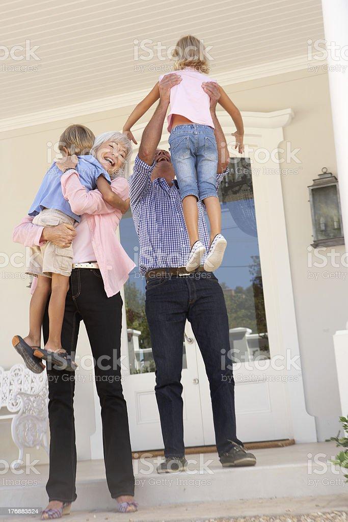 Grandparents Welcoming Grandchildren On Visit royalty-free stock photo