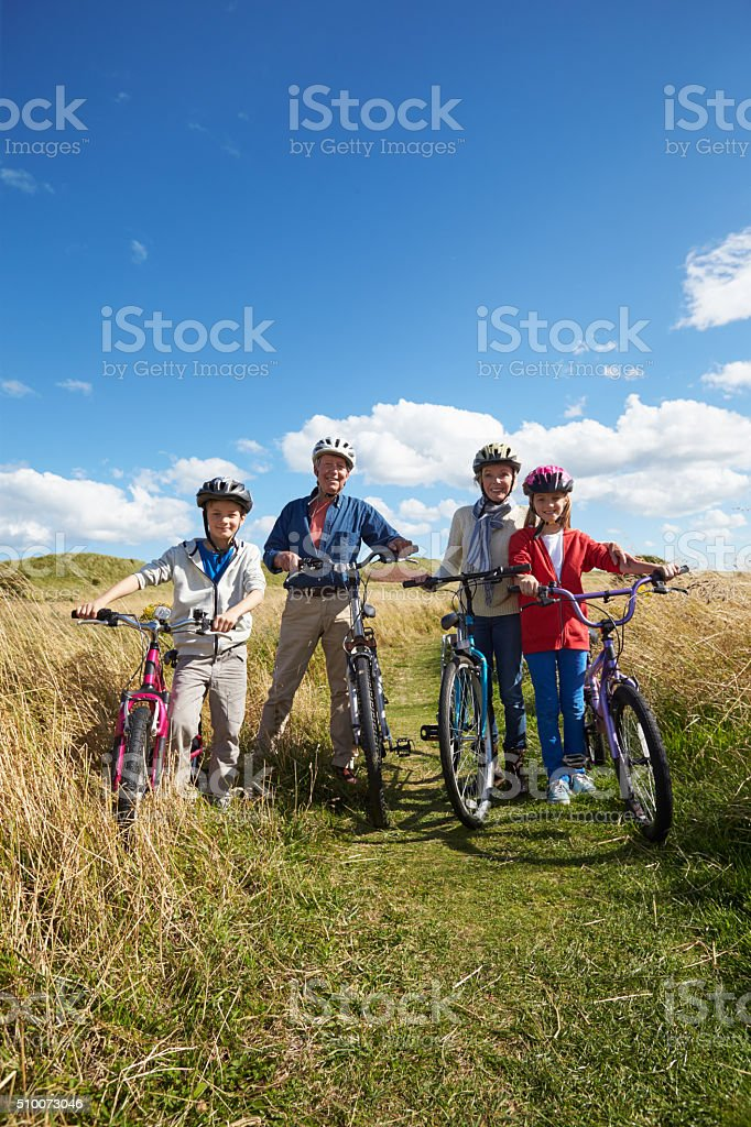Grandparents With Children Cycling Through Countryside stock photo