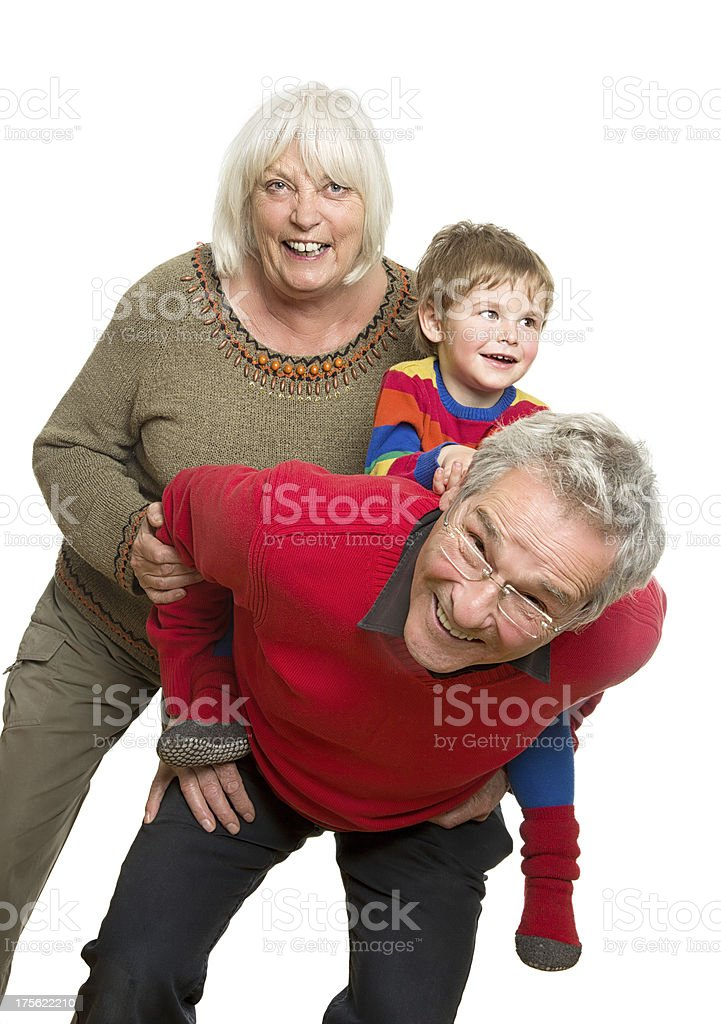 Grandparents with Grandchild on White Background - Having Fun royalty-free stock photo