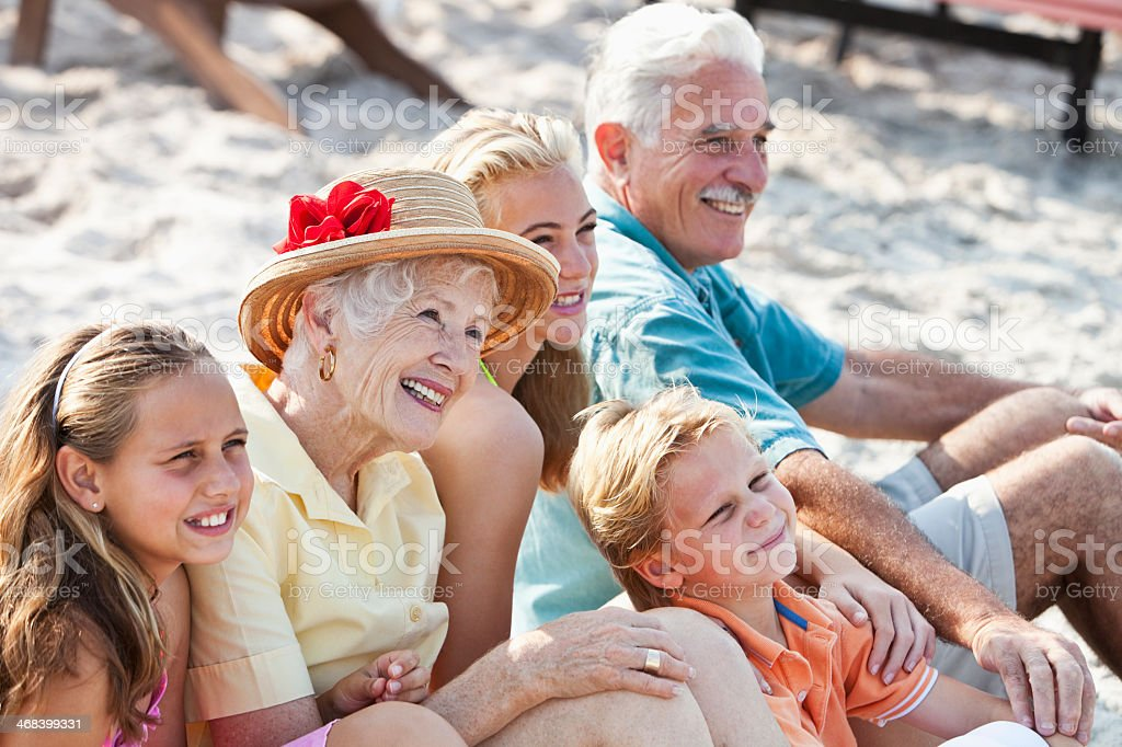 Grandparents with grandchildren at beach royalty-free stock photo