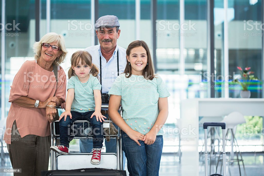 Grandparents with grandchildren happy before holidays stock photo