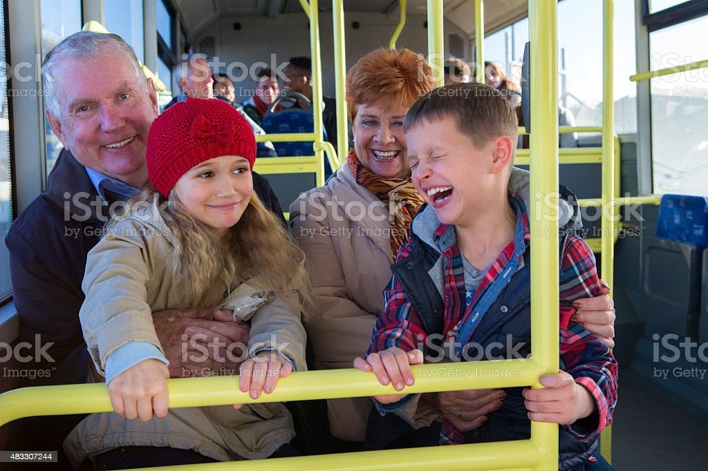 Grandparents with grandchildren on the bus stock photo