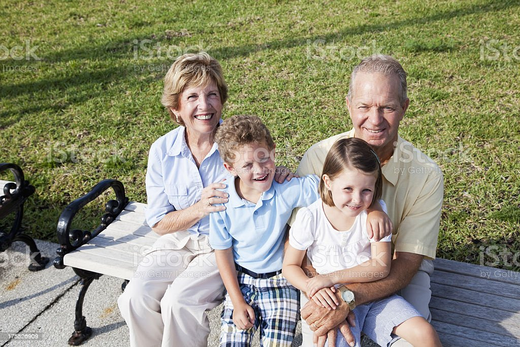 Grandparents with grandchildren stock photo