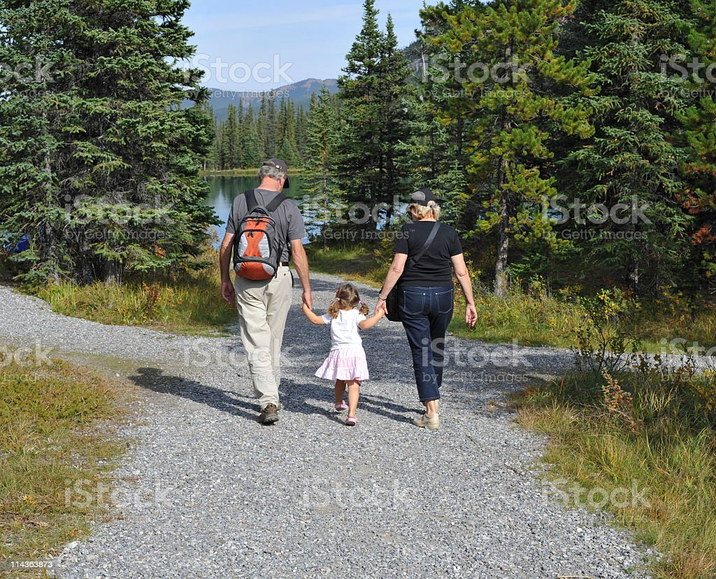 Grandparents with granddaughter near Forget-Me-Not Lake , Alberta,Canada royalty-free stock photo