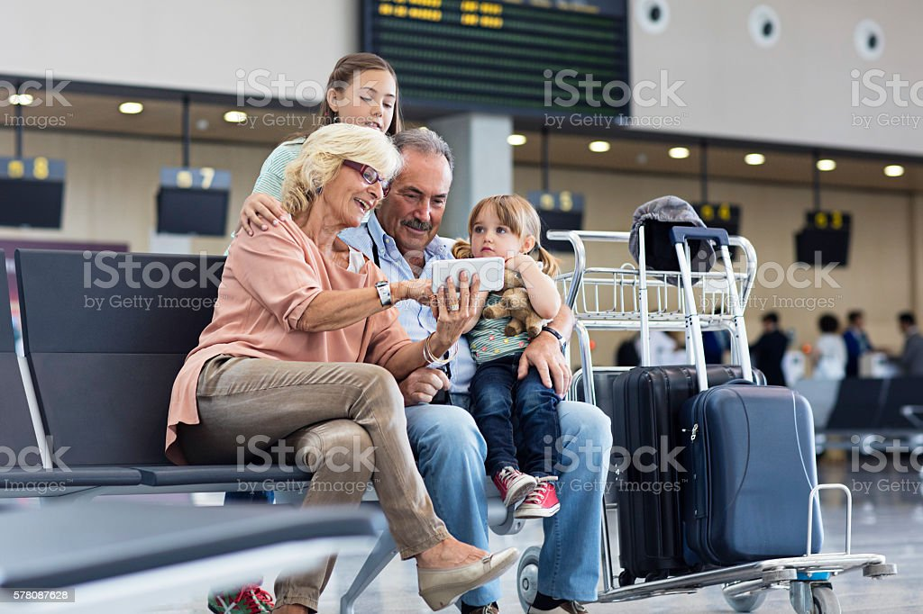 Grandparents with granddaughter travelling together on holidays stock photo